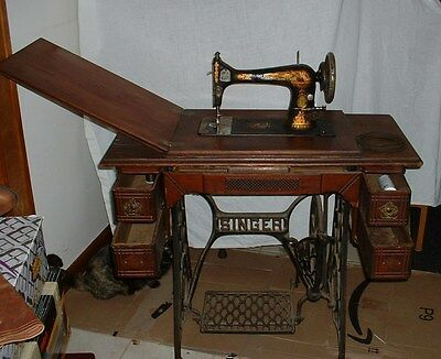 Singer Treadle Sewing Machine in 5 Drawer Cabinet