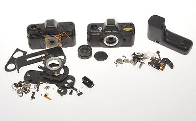 Pentax Auto 110 with 24/2.8 and winder, disassembled not complete, sold as is