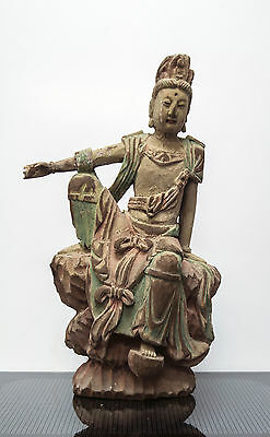 A LARGE CARVED AND POLYCHROME WOOD FIGURE OF GUANYIN possibly mid Qing dynasty