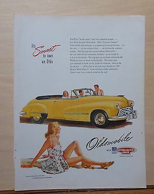 1947 magazine ad for Oldsmobile - Custom Cruiser Convertible Coupe at beach