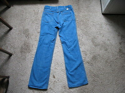 Vintage 1970s Blue Wrangler Jeans Bell Bottoms Size 33 Stretches Out To 35