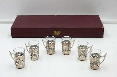 "(x6) ANTIQUE SET OF 2"" SHOT GLASSES AND STERLING SILVER? HANDLED HOLDERS"