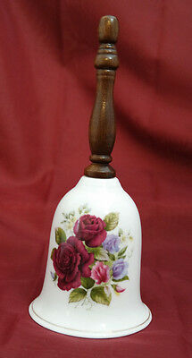 Collectible White Ceramic Bell with a Design of Roses Wooden Handle 11/30*600 ++