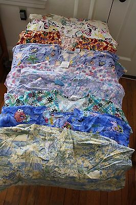 Lot 2X scrubs 4 pants and 9 tops mixed brands and patterns (1)