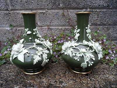 Fine pair of antique ceramic vases - green bottle vases with applied flowers