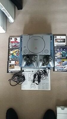 Sony Play Station PS1 with 2 controllers memory card and six Games