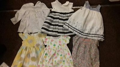 5 Girls dresses age 3-6 months.