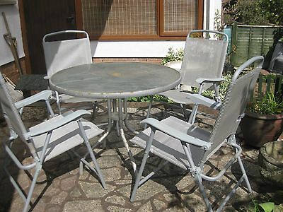 Patio glass top table and 4 chairs