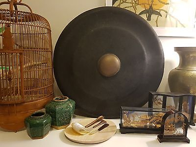 Large 60cm Indonesian Gamalan Gong with hanging ropes for interior decor.