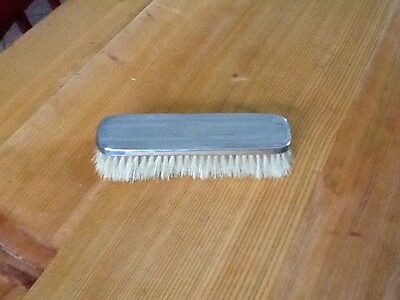 silver topped clothes brush