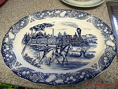 blue & white meat platter 2 horse riders with old locomotive in bak ground