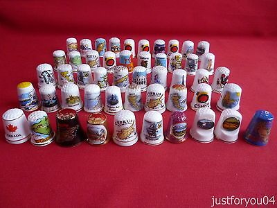 Job lot 50 mixed around the world collectors thimbles.