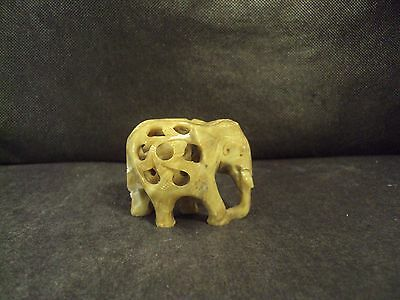 Antique hand carved elephant with baby inside soap stone jade color stone