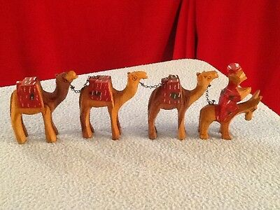 Vintage Hand Carved Wooden Camel Team Figurines 3 Camels with leader on a donkey