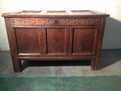 A EARLY 18th CARVED OAK COFFER