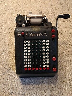 vintage corona portable adding machine with label from san francisco