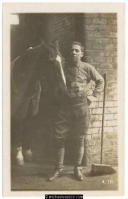 Horse and unidentified man, stables