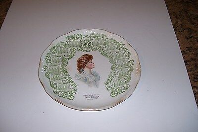 1909 CALENDAR PLATE w/ADV.-COMPLIMENTS OF FRED ZIEGLER-TOMAH,WIS.-Has Chip
