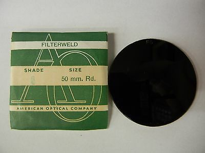 https://www.picclickimg.com/d/l400/pict/332226646175_/Vintage-American-Optical-Filterweld-Glass-50mm-Round-F6.jpg