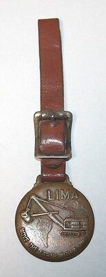 1940's watch fob.  MOVE THE EARTH WITH A LIMA.  LIMA, OHIO., BALDWIN CORP.