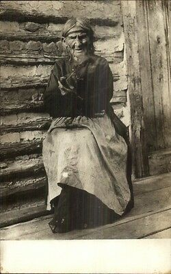 Old Native American Indian Woman on Porch Smoking Pipe c1910 RPPC