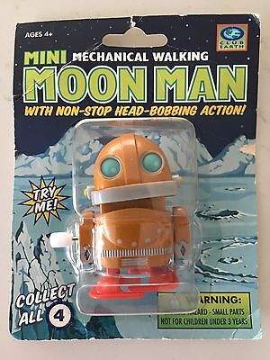 Club Earth Moon Man Mini Mechanical Walking Robot. Wind Up. New And Unopened.
