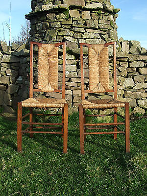 Pair of Arts and Crafts oak and woven rush side chairs