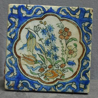 Very Nice painted Persian majolica tile with a flower decor. ca 1900