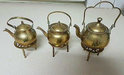 Gorgeous set of 3 brass teapots on stands!