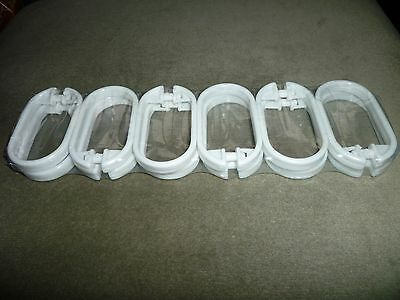 12 White plastic shower curtain hooks. oval shaped approx 6cms. come packaged