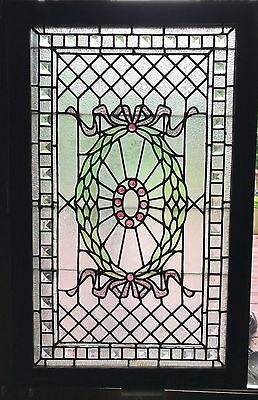 Beveled and jeweled stained glass panel