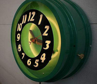 """A 14"""" Curtis Neon Clock, floating numbers,  A clock that will last a lifetime."""