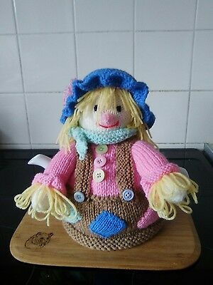 Handknitted scarecrow tea cosy