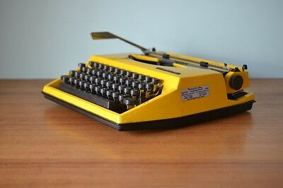 Vintage yellow portable Typewriter Adler Tippa retro