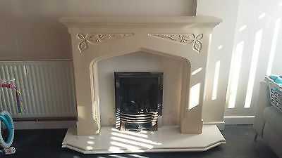 plaster cast fire surround with gas fire and marble hearth/backplate.