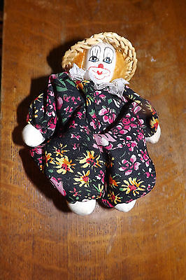 5-inch glass clown with colorful outfit, rattan hat & beautiful sock-knit face