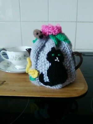 Handknitted cat and mouse small tea cosy