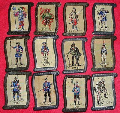 Complete Set of 12 WHW Historic Uniform & Weapon Tinnies from 1938 - C/A p 36