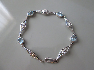 Beautiful ladies 925 Silver bracelet set with blue Topaz gems.