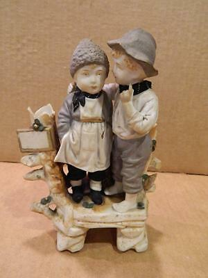 Bisque Figurine of a Boy & Girl Whispering Matte Finish Antique
