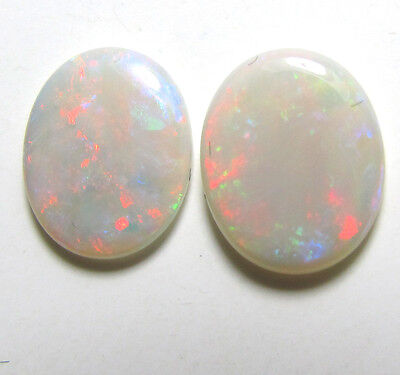 matched pair of solid white opals, 11 x 9 mm each, 2.6 carats, good color, fire