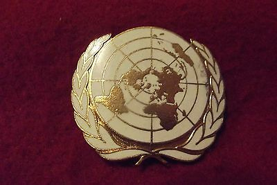 Queens Crown Era Enamel And Brass Cap Badge To The United Nations