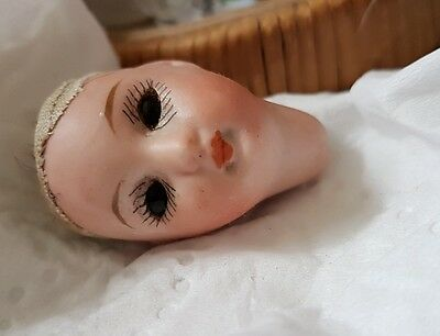 bisque doll head with eyes.  Germany 39 13