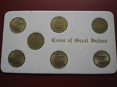 Queen Elizabeth II 1961 - 1967 3d Pence 7x coin set good grades housed in card
