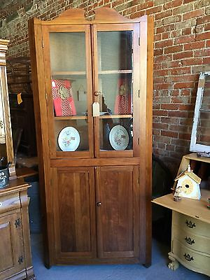 Antique walnut corner cabinet in good condition