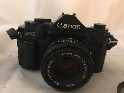 Canon A1 SLR camera With 3 Lenses 50mm 135 Mm and 35mm Lens New Seals Case