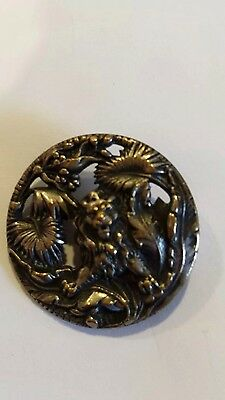 Antique pictorial brass button with lion