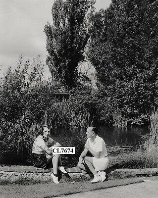 Gertrude Lawrence Sits with Noel Coward by the Side of a Pond Photo