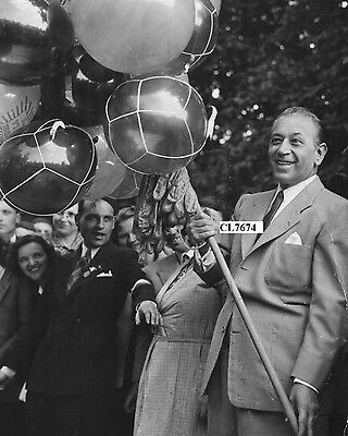 George Raft Selling Balloons at a Charity Fair in Tuileries Garden, Paris Photo