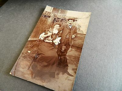 Edwardian photo postcard of a man & woman with pets